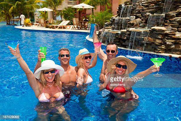 energetic adults toasting in pool xxxl - sea swimming stock photos and pictures