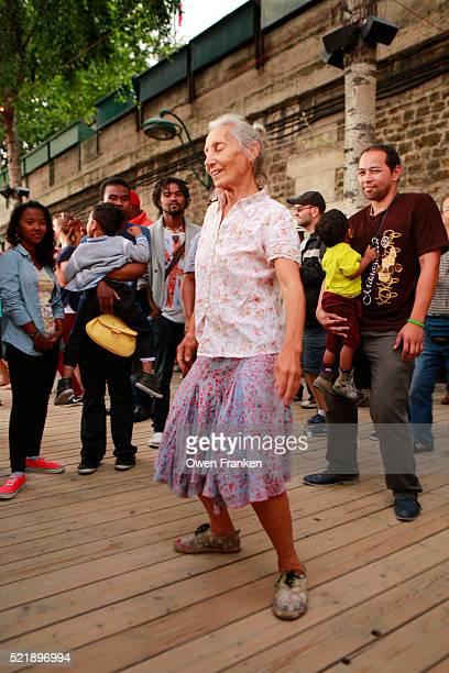 Energetic elderly woman dancing at the Paris Plage