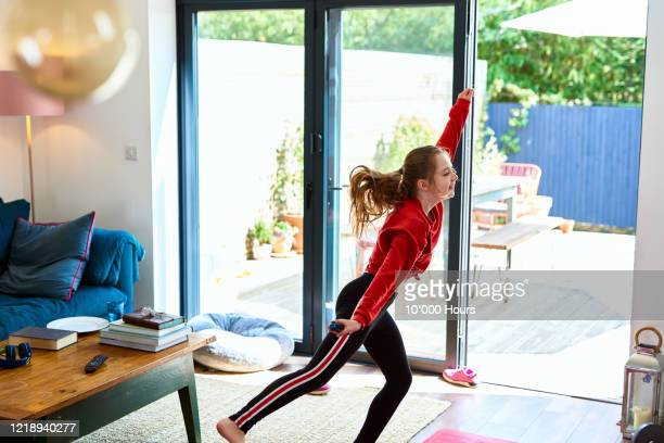 energetic girl dancing and having fun at home during lockdown - one girl only stock pictures, royalty-free photos & images