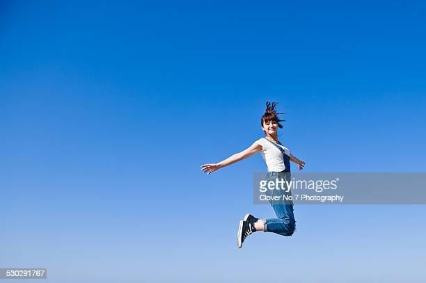 Energetic girl jumping.