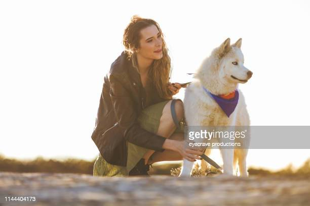 energetic teenage female exploring colorado outdoors with husky dog in the wild series - hairy girl stock pictures, royalty-free photos & images
