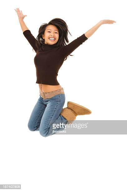 Energetic Young Woman Jumping