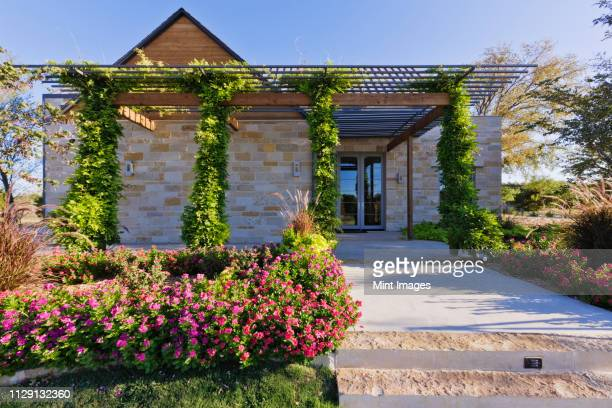 energy efficient home exterior - stone house stock pictures, royalty-free photos & images