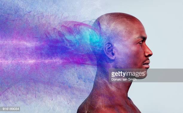 Energy flowing behind head of man