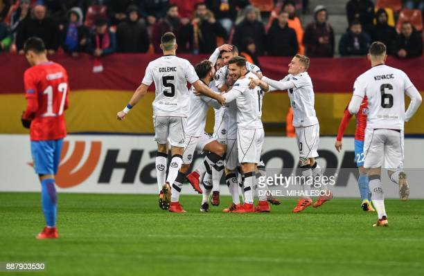 Energy Investment Lugano's players celebrates after Fabio Daprela scored the 01 against of Steaua Bucharest during the UEFA Europa League group G...