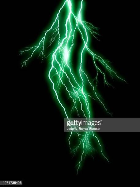 energy, lightning on black background. - lightning stock pictures, royalty-free photos & images