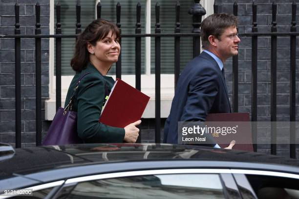 Energy Minister Claire Perry and Business Secretary Greg Clark leave number 10 following a Cabinet meeting in Downing Street on January 30 2018 in...