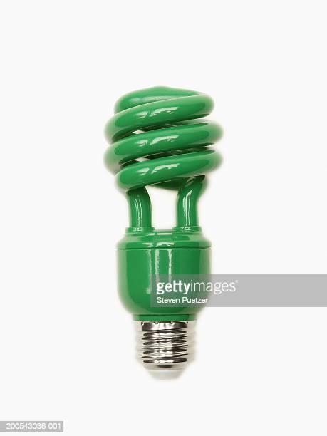 energy saving green spiral fluorescent lightbulb - bombilla de bajo consumo fotografías e imágenes de stock