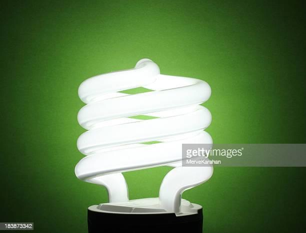 energy saving light bulb - energy efficient lightbulb stock photos and pictures