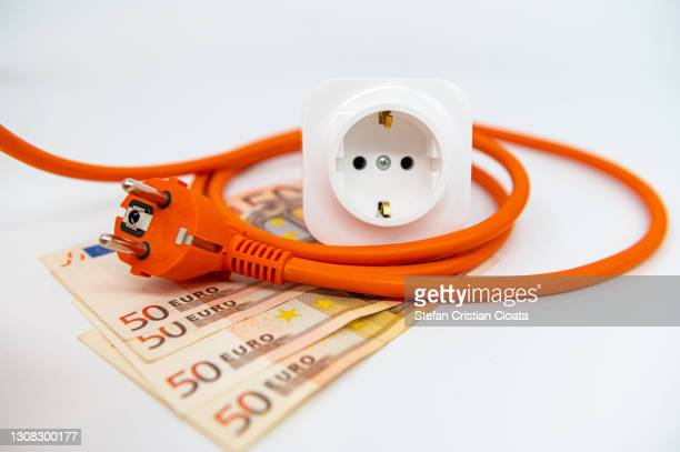 energy saving, plug, outlet and european notes - consumerism stock pictures, royalty-free photos & images