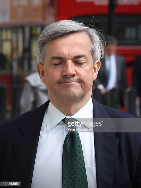 Energy Secretary Chris Huhne arrives at The Cabinet Office entrance for a Cabinet meeting on May 17 2011 in London England Mr Huhne is facing a...