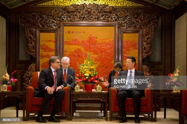 US Energy Secretary Rick Perry listens to China's Vice Premier Zhang Gaoli during a meeting at the Zhongnanhai leaders compound in Beijing on June 8...