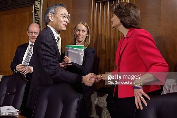 S Energy Secretary Steven Chu greets Senate Energy and Natural Resources Committee raking member Sen Lisa Murkowski before a committee hearing on...