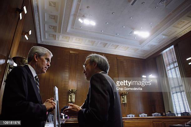 S Energy Secretary Steven Chu talks with Senate Energy and Natural Resources Committee Chairman Sen Jeff Bingaman before a committee hearing on...