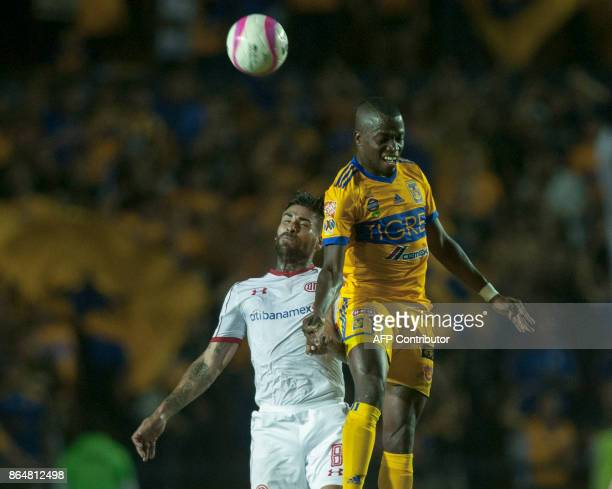 Enero Valencia of Tigres vies for the ball with Jesus Mendez of Toluca during their Mexican Apertura 2017 tournament football match at the...