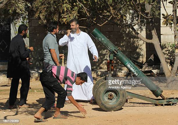 Enes Abdulhamid Zir Commander of Yusuf al'Azma Brigade of the Free Syrian speaks wuith his men next to a missile launcher on September 62013 near...