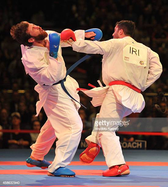 Enes Erkan of Turkey fights against Sajad Ganjzadeh of Iran during the male's final 84kg kumite competition of the 22nd Karate World Championship in...