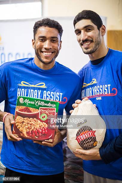 Enes Kanter and Josh Huestis of the Oklahoma City Thunder hand out 400 Thanksgiving meals to families through the Latino Community Development Agency...