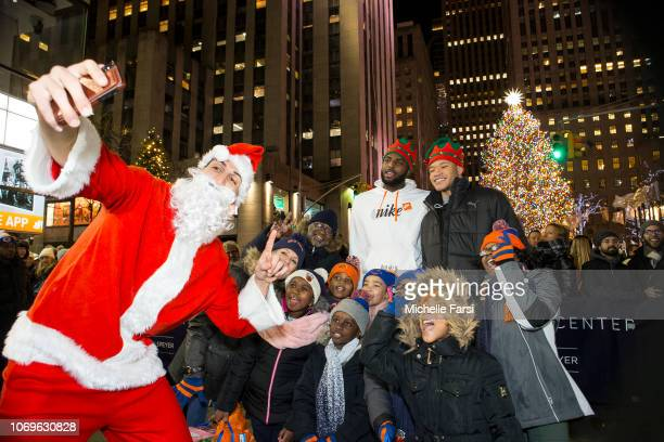 Enes Kanter Kevin Knox and Mitchell Robinson of the New York Knicks with tv personality Jill Martin surprise children from the Garden of Dreams...
