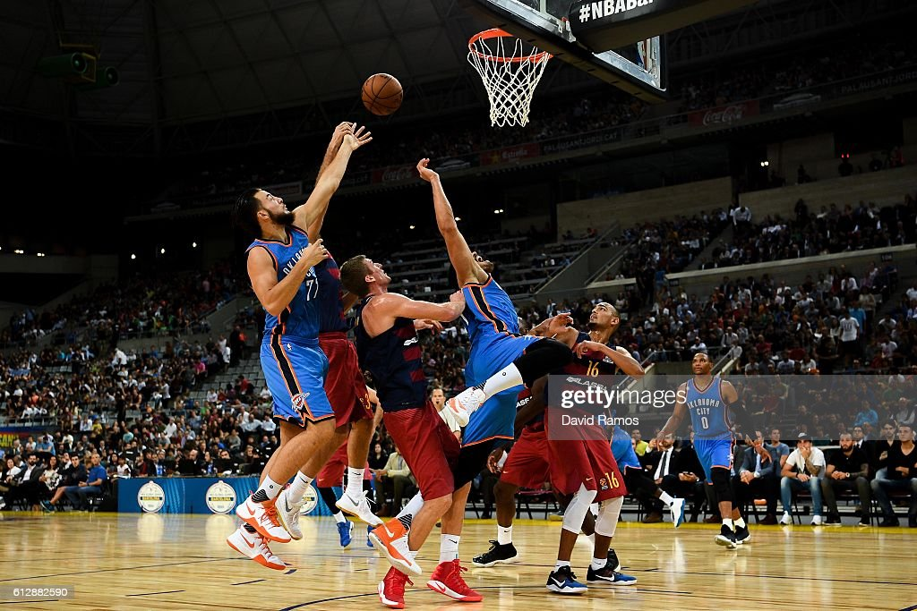 Enes Kanter (C) of Oklahoma City Thunder competes for the ball with for the rebound during the NBA Global Games Spain 2016 match between FC Barcelona Lassa and Oklahoma City Thunder at Palau Blaugrana on October 5, 2016 in Barcelona, Spain.