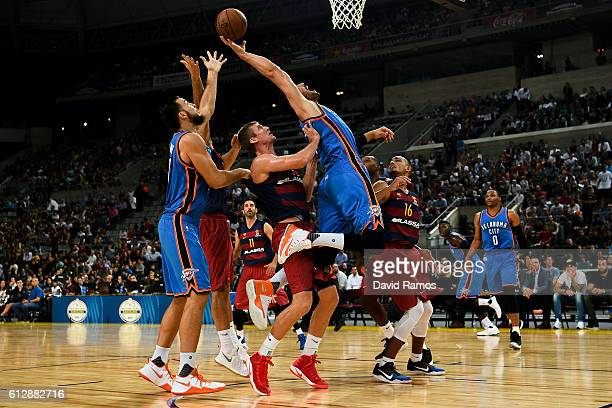 Enes Kanter of Oklahoma City Thunder competes for the ball with for the rebound during the NBA Global Games Spain 2016 match between FC Barcelona...