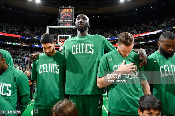 Enes Kanter of the Boston Celtics Tacko Fall of the Boston Celtics and Gordon Hayward of the Boston Celtics stands for the national anthem before the...
