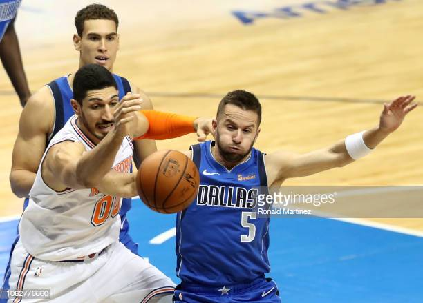 Enes Kanter of the New York Knicks and JJ Barea of the Dallas Mavericks chase a loose ball at American Airlines Center on November 02 2018 in Dallas...