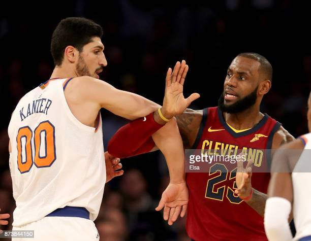 Enes Kanter of the New York Knicks and LeBron James of the Cleveland Cavaliers fight for position at Madison Square Garden on November 13 2017 in New...