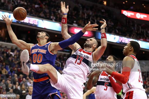 Enes Kanter of the New York Knicks and Marcin Gortat of the Washington Wizards battle for a rebound during the first half at Capital One Arena on...