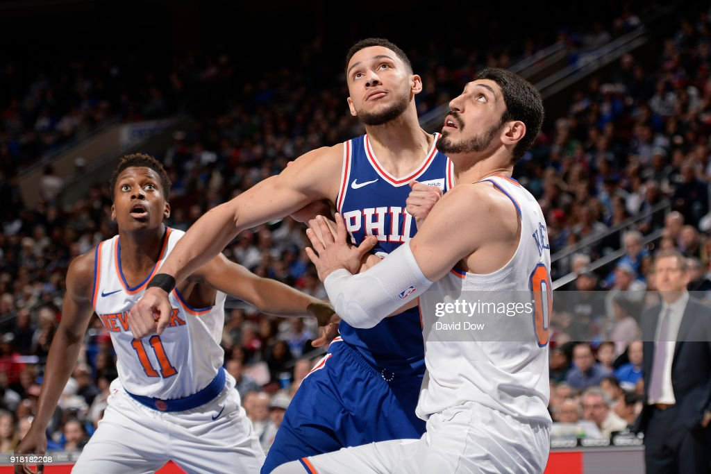 Enes Kanter #00 of the New York Knicks boxes out Ben Simmons #25 of the Philadelphia 76ers on February 12, 2018 in Philadelphia, Pennsylvania at Wells Fargo Center.