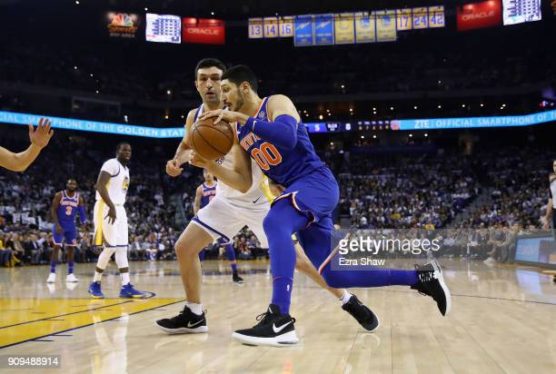 Enes Kanter of the New York Knicks drives on Zaza Pachulia of the Golden State Warriors at ORACLE Arena on January 23 2018 in Oakland California NOTE...