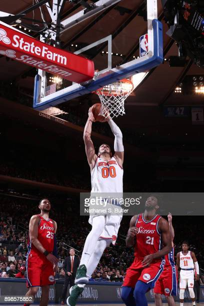 Enes Kanter of the New York Knicks dunks the ball against the Philadelphia 76ers on December 25 2017 at Madison Square Garden in New York City New...