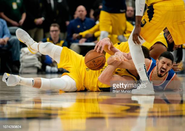 Enes Kanter of the New York Knicks fights for a loose ball during the first half of the game against the Indiana Pacers at Bankers Life Fieldhouse on...