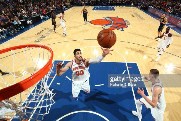 Enes Kanter of the New York Knicks grabs the rebound against the Indiana Pacers on November 5 2017 at Madison Square Garden in New York City New York...