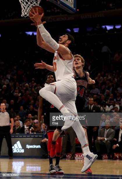 Enes Kanter of the New York Knicks heads for the net as Lauri Markkanen of the Chicago Bulls defends at Madison Square Garden on January 10 2018 in...