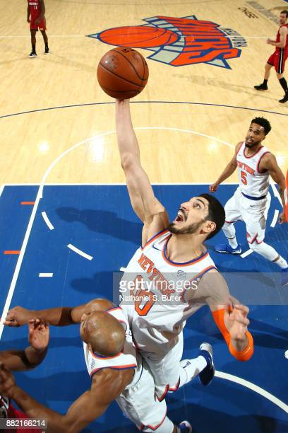 Enes Kanter of the New York Knicks rebounds the ball during the game against the Miami Heat on November 29 2017 at Madison Square Garden in New York...
