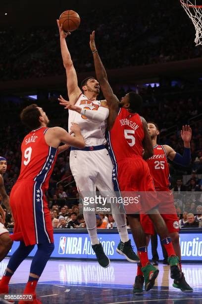 Enes Kanter of the New York Knicks shoots the ball against Amir Johnson of the Philadelphia 76ers at Madison Square Garden on December 25 2017 in New...