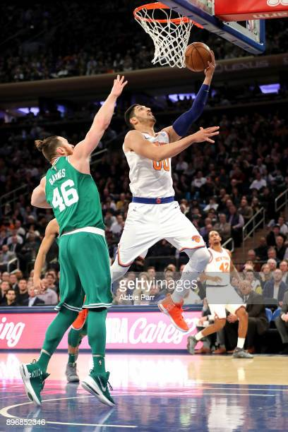 Enes Kanter of the New York Knicks takes a shot against Aron Baynes of the Boston Celtics in the first quarter during their game at Madison Square...