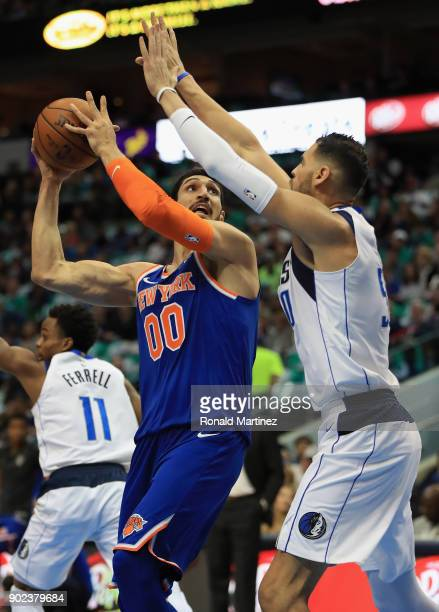 Enes Kanter of the New York Knicks takes a shot against Salah Mejri of the Dallas Mavericks at American Airlines Center on January 7 2018 in Dallas...
