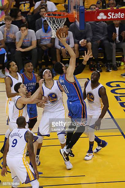 Enes Kanter of the Oklahoma City Thunder drives to the basket against the Golden State Warriors in Game Five of the Western Conference Finals during...