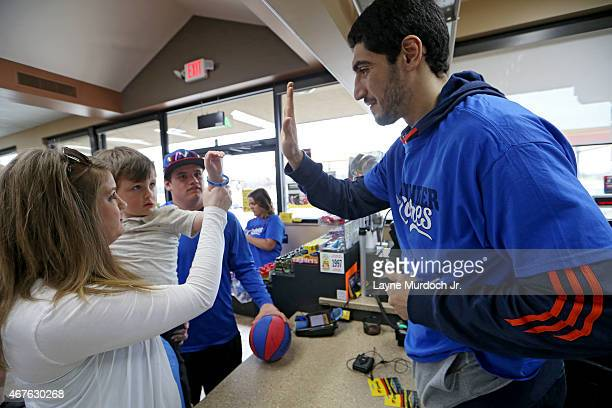 Enes Kanter of the Oklahoma City Thunder participates in the Thunder's annual Random Acts of Kindness by making customer's sandwiches at Subway on...
