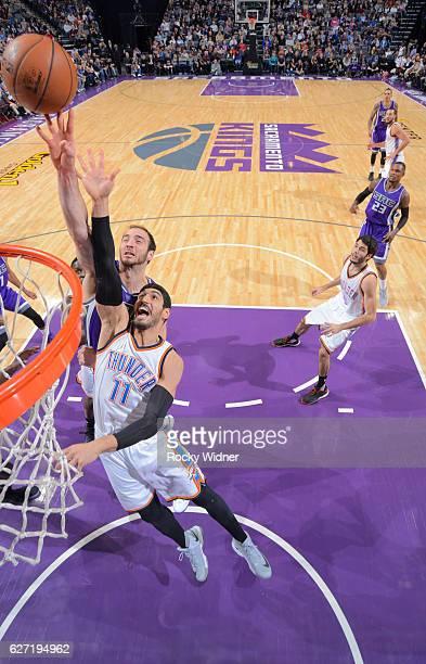 Enes Kanter of the Oklahoma City Thunder rebounds against Kosta Koufos of the Sacramento Kings on November 23 2016 at Golden 1 Center in Sacramento...