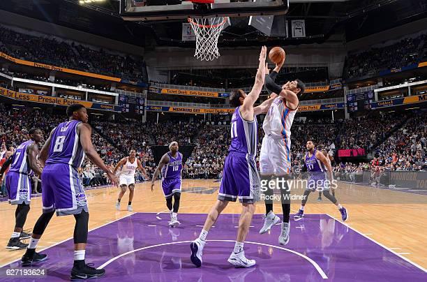 Enes Kanter of the Oklahoma City Thunder shoots against Kosta Koufos of the Sacramento Kings on November 23 2016 at Golden 1 Center in Sacramento...