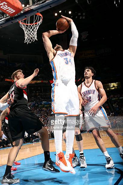 Enes Kanter of the Oklahoma City Thunder shoots against the Portland Trail Blazers on April 13 2015 at Chesapeake Energy Arena in Oklahoma City...