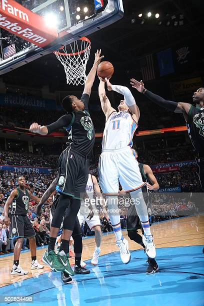 Enes Kanter of the Oklahoma City Thunder shoots the ball against John Henson of the Milwaukee Bucks on December 29 2015 at Chesapeake Energy Arena in...