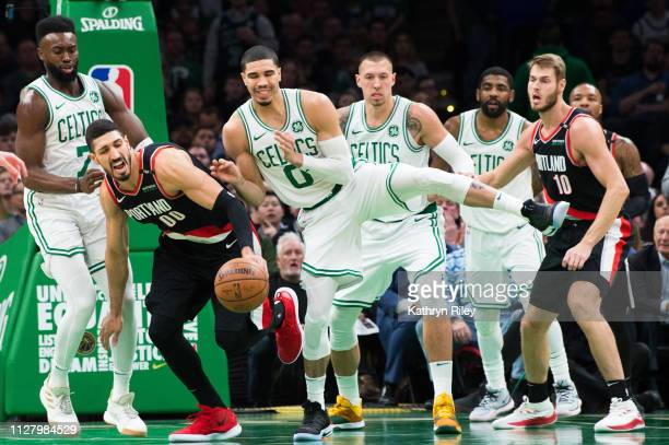 Enes Kanter of the Portland Trail Blazers fights for the rebound against Jayson Tatum and Jaylen Brown of the Boston Celtics at TD Garden on February...