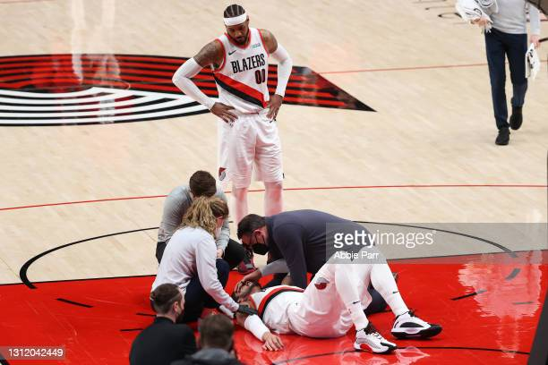 Enes Kanter of the Portland Trail Blazers is attedned to after being injured in the third quarter against the Miami Heat at Moda Center on April 11,...