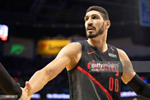 Enes Kanter of the Portland Trail Blazers is congratulated after scoring and drawing a foul during a game against the Oklahoma City Thunder during...
