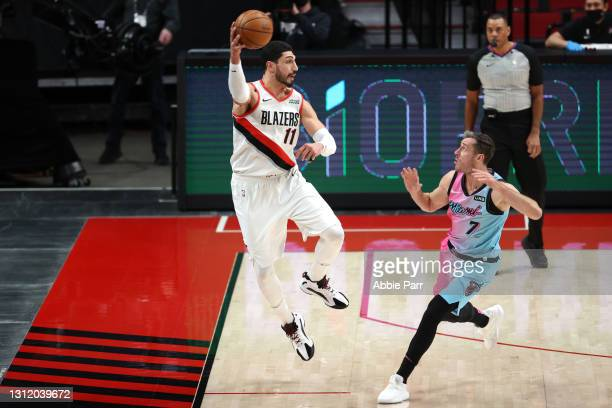 Enes Kanter of the Portland Trail Blazers passes the ball in the second quarter against Goran Dragic of the Miami Heat at Moda Center on April 11,...