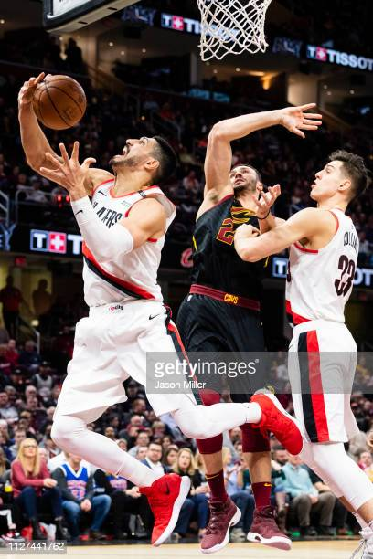 Enes Kanter of the Portland Trail Blazers tries to grab a rebound over Larry Nance Jr #22 of the Cleveland Cavaliers during the second half at...